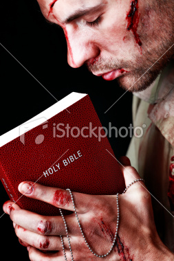 Ist2_11885634-wounded-soldier-holding-bible